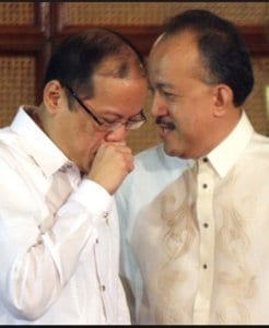 In happier times: Akbayan political adviser Llamas whispering something to Aquino. But is he with Erap now?